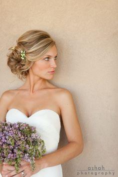 Loose updo wedding hair. Visit www.rosetintmywedding.co.uk for bespoke wedding planning and design UK.