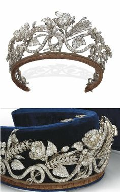AN ANTIQUE DIAMOND TIARA mid-19th Century. Designed as a continuous scrolling old-cut diamond line with wheat sheaves, flowers, leaves and buds all interwoven, in a blue velvet fitted E. Böhm Vienna case. Mid 19c naturalistic style.