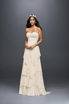 An A-line wedding dress is universally flattering, and this Melissa Sweet gown's layers of weightless chiffon move gracefully. Exclusively at David's Bridal.