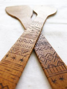 Wood Servers with woodburned detail made from salvaged birch swedish graphic design.