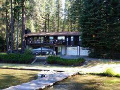 Year round home with 95' frontage at end of quiet and protected inlet on the pristine south side of the Spokane River & navigable to Lake CDA.