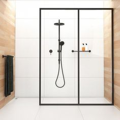 Industrial shower with black showerhead and steel framed glass is warm and inviting. So easy to emulate.