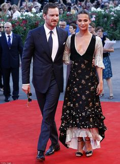 Loved up: Michael; Fassbender and Alicia Vikander, in Louis Vuitton, arrived with their arms around each other at the premiere of The Light Between Oceans at the Venice Film Festival on Thursday evening