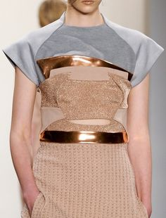 Overlapping blocks, line & curve, neutral colours, a flash of metallics & mixed textures - sports luxe, fashion details // Louise Goldin ss13
