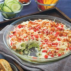 Layered Bean Dip  Here's a healthy version of the all-time party favorite. A hearty serving of Layered Lima Bean Dip weighs in at only 172 calories.                                         Top lightly with shredded cheese and bacon. You'll be surprised at how fast it'll disappear.