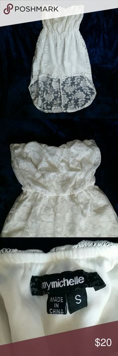 High-low rose lace dress! This pretty strapless dress is off white, rose lace allover, size small.  But im never a small in anything and it fits me. Worn lightly the clear straps for hanging it are cut off. My Michelle Dresses High Low