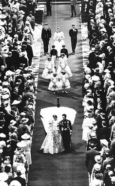 Prince Charles and his bride Diana, Princess of Wales, march down the aisle of St. Paul's Cathedral at the end of their wedding ceremony on July 29, 1981 in London. The bride's maids and the groom's brothers Prince Andrew, top left, and Prince Edwards, top right, march behind them.  (AP Photo)