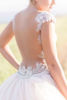 low illusion back - photo by B Jones Photography http://ruffledblog.com/sophisticated-nautical-bluff-wedding