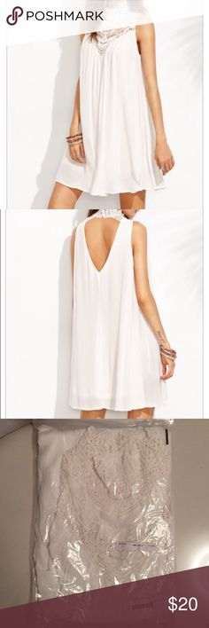 Off White Dress S New !! Off white Sleeveless Appliques High Neck Hollow Back Dress. Size Small . Dresses Mini