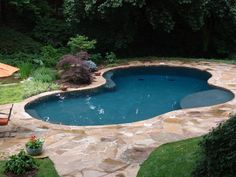 The deck stone and pool design blend in beautifully with the natural ...