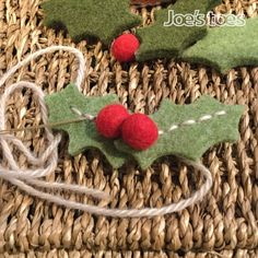 A pair of holly leaves and three berries cut from our thick wool felt. The leaves have a row of holes down the centre for easy stitching. These felt leaves look really lovely as a festive slipper trim, on a felt wreath or to trim a package. They also make