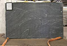 Honed black granite with white veins! looks like soapstone