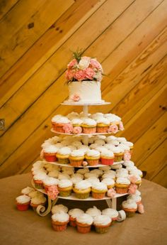 cupcakes with small cake for bride and groom
