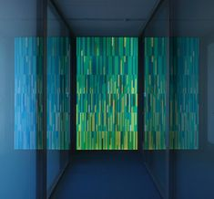 "Frick Chemistry Lab: Pixelated Glass Wall: by Paul Houseberg: 6 walls each with a different color scheme, doubling as a wayfinding system, have been installed in Princeton's new science facility. Each wall is a mosaic of dozens of tiles each made of 1/8"" strips of glass which were cut and then fused."