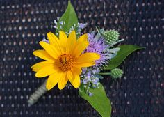 For the Groom.  Heliopsis flower with thistle and liatris.