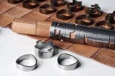 RAW Studio leather & metal portable chess set, pieces slide onto the rolled up leather playing field