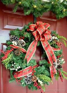 Evergreen branches look especially beautiful with a plaid red bow.  Get the tutorial at The Frugal Homemaker »  - GoodHousekeeping.com
