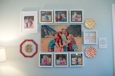 family gallery wall. love the number 6 for the amount of people in the family