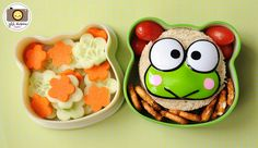 LUNCH BOX tier held a circle-cut sandwich with a keroppi the frog (from Helly Kitty) on top. Also snuck in a few baby tomatoes and pretzel twists. The other tier held flower cut cucumbers and carrots. School Snacks, School Lunch, Baby Tomatoes, Myla, Bento Box Lunch, Healthy Lunches, Twists, Pretzel, Kids Meals
