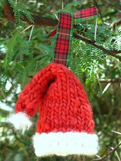 Ravelry: Knitted Santa Hat Christmas Ornament pattern by Linda Dawkins Would love this on my white tree with all red decor this year!