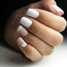 Elegant White Nail Art. If you want to keep it simple, try this amazing yet elegant white nail art design, that can go perfect with your casual and as well as formal events.