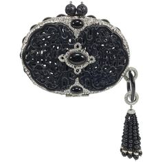 Iradj Moini Carved Black Jade Minaudière with Extraordinary Tassel   From a collection of rare vintage evening bags and minaudières at https://www.1stdibs.com/fashion/handbags-purses-bags/evening-bags-minaudieres/