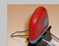 Painting rocks tip - use a binder clip to hold thin stones for double-sided painting