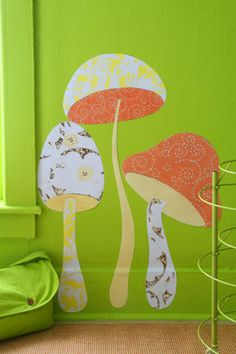 Download the mushroom pattern  and enlarge to desired size on a printer. (For extra-large results, you may have to visit a local copy center.) Use the patterns as templates to cut shapes from fun, lively fabric. Iron the fabric onto fusible webbing (available at crafts stores), then adhere to the wall. Designer Matthew Mead used Mod Podge to make his mushrooms stick.
