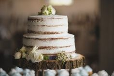 A Beautiful Wedding Cake On Wooden Plate Fair Spring Ceremony
