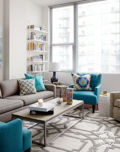 "A Bold, Rental-Friendly Redesign in Chicago - The strong patterned area rug from <a href=""http://www.horchow.com/Global-Views-Gray-Abstract-Rug-Silver-Gray/cprod89510101_cat15320731__/p.prod?icid="