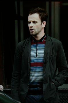 Jonny Lee Miller wearing John Smedley style Arnewood
