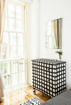 Yes, you can DIY your old dresser to look like this black & white grid patterned statement piece.