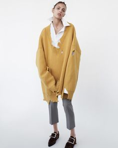 Anja wears jumper, shirt and trousers Raf Simons (menswear). Shoes Maison Margiela. Earring stylist's studio.  Anja Rubik, 33, modeling for 18 years. amy troost
