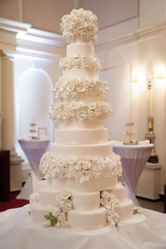 The magnificent centrepiece of the event was a breathtaking 10-tier wedding cake which was decorated with over 500 individually handcrafted sugar flowers, which took 150 man hours to create! Description from weddingideasmag.com. I searched for this on bing.com/images