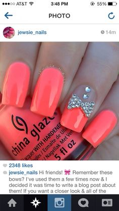 neon pink nails with diamond bow design