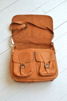 Vintage 1970s large tan leather crossbody bag with large flap closure, roomy interior, double buckled boxes under the main flap and adjustable shoulder strap.  --- M E A S U R E M E N T S ---  14 x 12 3 wide base 32-42 adjustable long strap maker/brand: n/a condition: excellent  ➸ More vintage bags http://www.etsy.com/shop/DearGolden?section_id=10308208  ➸ Visit the shop http://www.DearGolden.etsy.com _____________________  ➸ instagram   deargolden ➸ twitter   deargolden ➸ facebook.com…