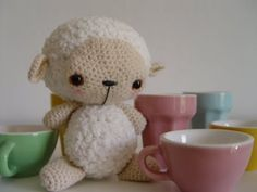 This sheep made with the pattern found here:  http://harugurumi.blogspot.com/2008/02/baby-sheep-free-pattern.html