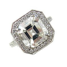 A diamond and platinum ring centering an Asscher-cut diamond weighing 4.00 carats, the mount micro-set with round brilliant-cut diamonds; estimated total diamond weight: 4.70 carats.