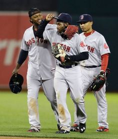 Boston Red Sox outfielders, from left, Hanley Ramirez, Jackie Bradley Jr. and Mookie Betts celebrate after beating the Oakland Athletics 5-4 in the eleventh inning of a baseball game Monday, May 11, 2015, in Oakland, Calif. (AP Photo/Ben Margot) Boston Red Sox Team Photos - ESPN