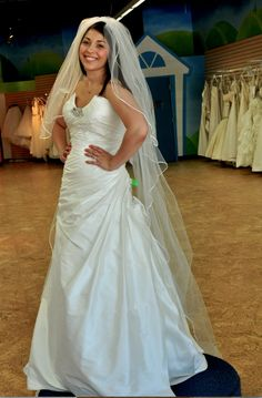 This gown is an Anaiss in Size 14, available in our salon at a steal of a price! All proceeds benefit the Cancer Support Community.