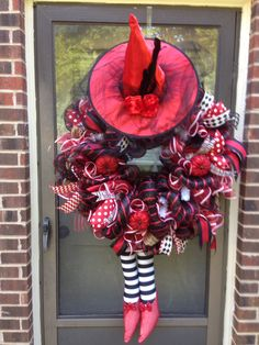 Red and black Halloween wreath. Check out more designs on my FB page: Ms. Kay's a-DOORable Designs.