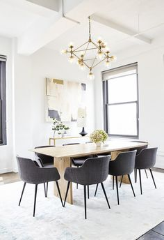"""""""Overall, I think we really transformed the space by swapping out most of the lighting with pendants and chandeliers,"""" says Rich. Kloss took inspiration for this conference table from the Soho House in Berlin 
