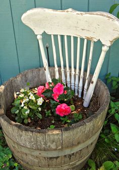 For the love of white: Shabby Chic Gardening top of a a pretty old chair painted a nice color for a large container good idea