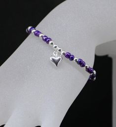 A beautiful summer Bracelet made with 925 sterling silver balls and Grape Toho Seed Beads and finished off with a gorgeous 9 mm sterling silver puffy heart. Summer Bracelets, Layered Bracelets, Colorful Bracelets, Beaded Bracelets, Silver Jewelry Cleaner, Heart Bracelet, 9 Mm, Stretch Bracelets, Silver Beads