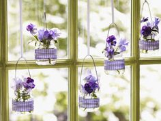 Purple Reigns:  Perfectly proportioned, re-purposed baby-food jars become gingham-banded, light-infused hanging vases for pansies.