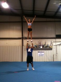 shoulder stand stunt where the flyer climbs or pups up