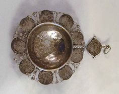 Description: A beautiful and unusual antique silver tea strainer. The strainer which has a central hemispherical silver strainer surrounded with Austrian silver coins. There is nine 3 Kruzers from the