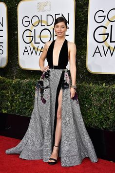 Spotted on the Golden Globes red carpet, Jessica Biel in a pair of Ferragamo satin sandals with ankle strap and chain detailing.