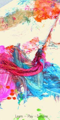 Homemade yarn paintbrushes - big art for kids