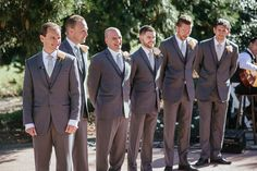 Matt Shumate Photography at Lawson Gardens outdoor summer wedding ceremony groomsmen in light grey suits during ceremony